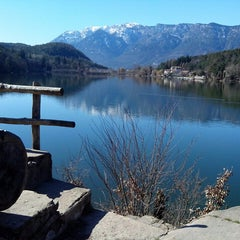 Photo taken at Montiggler See by Tobias H. on 3/9/2014