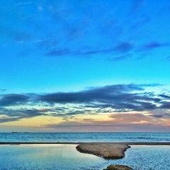 Photo taken at Praia Brava by Valerio V. on 7/25/2013