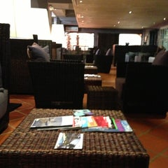 Photo taken at Big Banana Executive Lounge by Javier F. on 12/9/2012