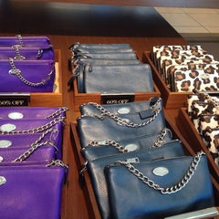 Photo taken at Coach Factory Store by Roselle D. on 7/27/2015