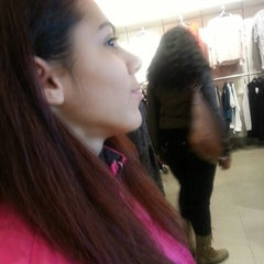 Photo taken at H&M by Evelyn H. on 12/28/2013