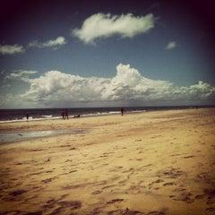 Photo taken at Praia do Pina by Millena S. on 1/30/2013