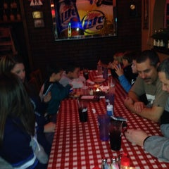 Photo taken at Filippi's Pizza Grotto by David S. on 12/31/2013