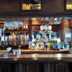 Photo taken at The Lion & Rose British Restaurant & Pub by Ethan K. on 9/17/2012