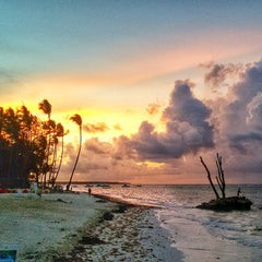 Photo taken at Los Corales Beach by Julia G. on 9/15/2014