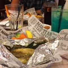 Photo taken at The Manhattan Fish Market by Izzati S. on 7/12/2015