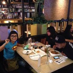 Photo taken at MUNCHIES Restaurant & Bar by Dodie T. on 3/3/2015