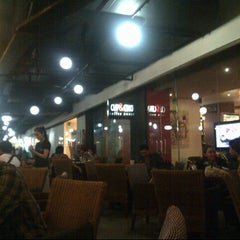 Photo taken at Cup & Cino Coffee House by Cintantya R. on 1/25/2013