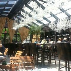 Photo taken at Isola Trattoria & Crudo Bar by Jeannie K. on 6/9/2013