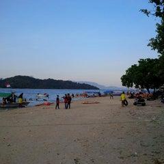 Photo taken at Pantai Mutun by Wahyu H. on 7/21/2015