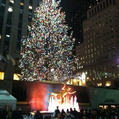 Photo taken at Rockefeller Center Christmas Tree by Patrick G. on 12/22/2012
