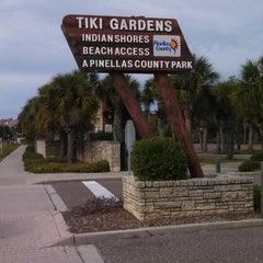 Photo taken at Tiki Gardens Beach Spot by John H. on 12/23/2013