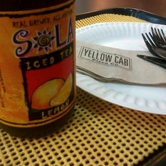 Photo taken at Yellow Cab Pizza Co. by Joanna P. on 12/7/2013