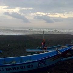 Photo taken at Pantai Kuwaru by David E. on 2/9/2014