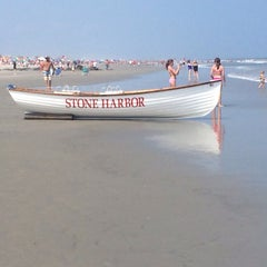 Photo taken at 89th Street Beach by Andi R. on 8/3/2014