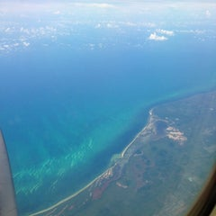 Photo taken at Aeropuerto Internacional De Cancún (CUN) by Ricardo O. on 8/8/2013