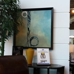Photo taken at Rooms To Go Furniture Store by Eileen H. on 4/17/2014