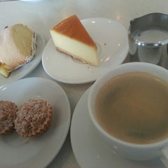 Photo taken at Dino Cake House & Cafe by Jessica L. on 5/11/2014