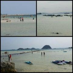 Photo taken at Pantai Pasir Putih by Nindita U. on 9/25/2015
