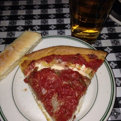 Photo taken at Gino's East by Lisa N. on 1/18/2014