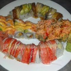 Photo taken at Tasu Asian Bistro Sushi & Bar by Stacey L. on 12/11/2012