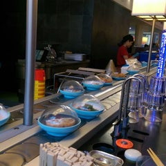 Photo taken at YO! Sushi by Carine T. on 4/20/2015