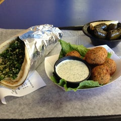 Photo taken at Papouli's Mediterranean Cafe and Market by Charles E. on 1/18/2014