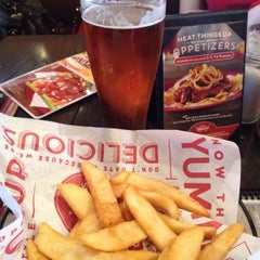 Photo taken at Red Robin Gourmet Burgers by Chris G. on 4/11/2015