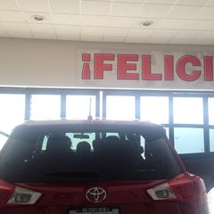 Photo taken at Toyota by Mariana O. on 7/9/2014