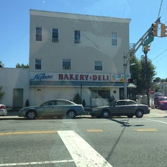 Photo taken at Neptune Bakery & Deli by Ray E. on 9/7/2013