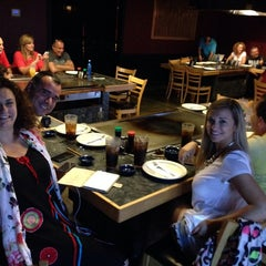 Photo taken at Tsunami Japanese Steakhouse and Sushi Bar by Oscar N. on 6/26/2014