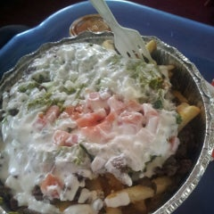 Photo taken at Tacos El Unico by Brian S. on 10/3/2014
