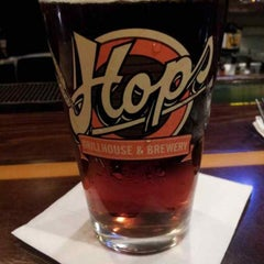 Photo taken at Hops Grill and Brewery by Jason C. on 8/22/2013