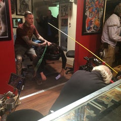 Photo taken at Stained Skin Tattoo by Durb M. on 4/15/2015