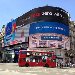 Photo taken at Piccadilly Circus by Adriana M. on 6/5/2013