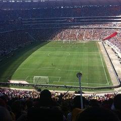 Photo taken at FNB Stadium by Mfanakhiti I. on 12/8/2012