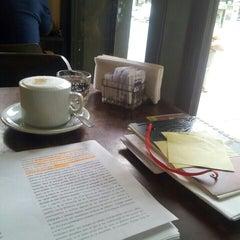 Photo taken at Mill Café by Melina P. on 3/11/2013