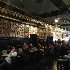 Photo taken at Flying Saucer Draught Emporium by Kelly B. on 3/25/2013