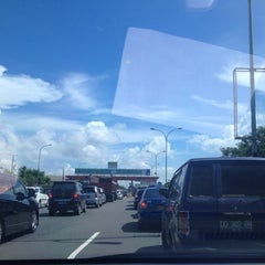 Photo taken at Gerbang Tol Parangloe by Erni Yanti on 4/18/2014