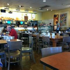 Photo taken at Einstein Bros Bagels by Beth D. on 6/30/2012