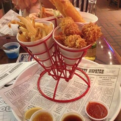 Photo taken at Bubba Gump Shrimp Co. by Bryce P. on 7/2/2012