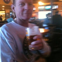 Photo taken at Oggi's Pizza & Brewing Co. by Theresa J. on 3/15/2012
