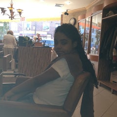Photo taken at Rizo's Beauty Salon by Vivi C. on 4/27/2012