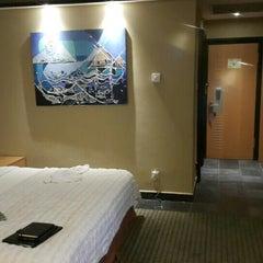 Photo taken at Le Méridien Ibom Hotel & Golf Resort by Seun O. on 7/15/2015