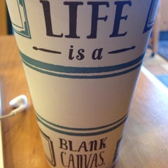 Photo taken at Caribou Coffee by Alli M. on 3/25/2014