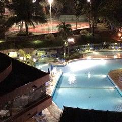Photo taken at Hotel Kualamana by Juan G. on 12/14/2014