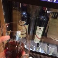 Photo taken at Loki Wine Merchant & Tasting House by Anthony L. on 3/24/2014
