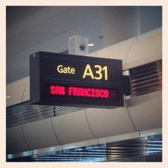 Photo taken at Gate A31 by Cheryl J. on 10/8/2012