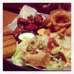 Photo taken at Buffalo Wild Wings Grill & Bar by Gian B. on 12/30/2012