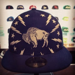 Photo taken at New Era Flagship Store: Buffalo by Dominic M. on 9/15/2012